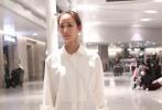 张钧甯穿白色长袖衬衫