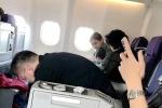 飞机上偶遇Angelababy 网友称小海绵见谁都会笑
